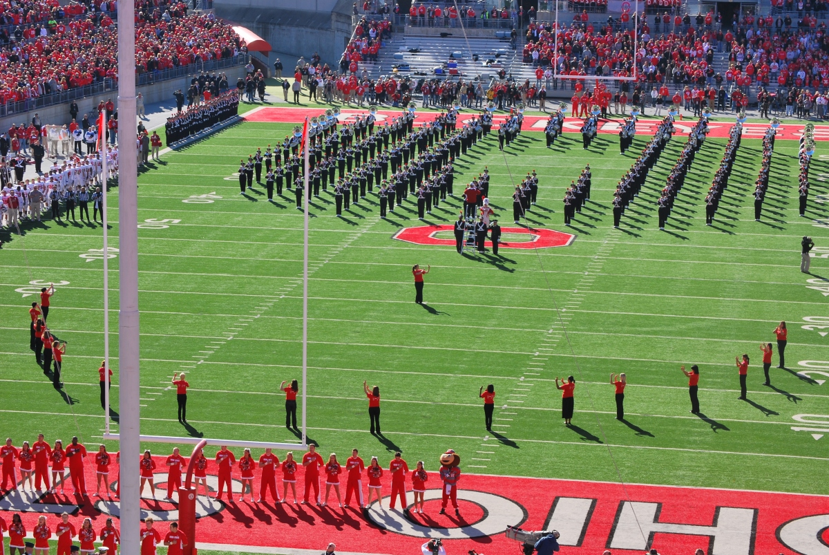 Picture of signers and marching band at OSU football game.